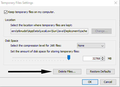 Arrow pointing to Delete Files button in Temporary Files Settings dialog box
